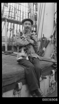 Seaman with a cat and kitten, c 1910, Australian Maritime Museum