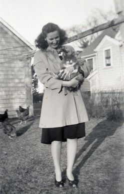 Woman holding cat, 1940s
