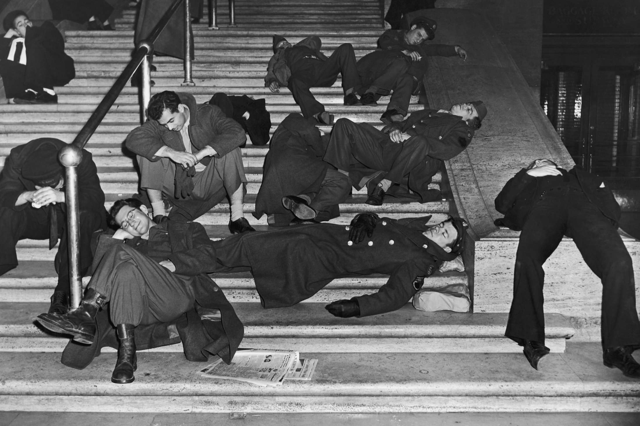 Revelers recovering from New Years Eve celebrations on the steps of Grand Central Station, New York, circa 1940.