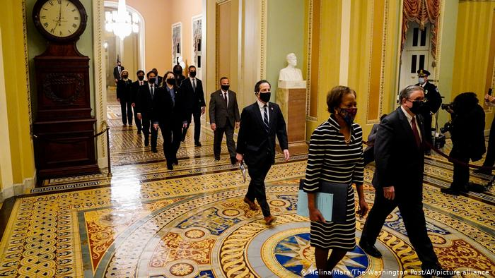 Clerk of the House Cheryl Johnson along with acting House Sergeant-at-Arms Tim Blodgett lead the Democratic House impeachment managers as they walk through the Capitol Hill